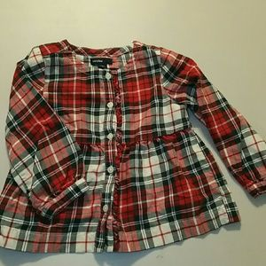 Plaid blouse with ruffle.